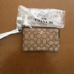 Coach wristlet signature in brown and cream